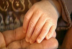 Baby Hubbarb - six fingers on each hand. Six toes  on each foot