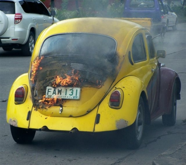 No, it's not a scene from the London riots, but a VW Beetle which caught fire in B S Aquino Drive in Bacolod City on Friday afternoon. No one was hurt. Motoring tip: a small fire extinguisher costs less than Php900. Much cheaper than replacing a burnt-out car. (Photo: Robert Harland)