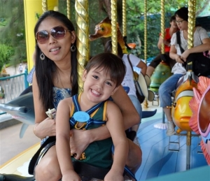 Robert Harland Jr with mum Stessie enjoying one of the many rides at Ocean Park (Robert Harland photo)