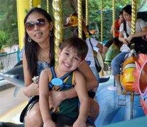 Robert Harland Jr with mum Stessie enjoying one of the many rides at Ocean Park (Robert Harland photo)