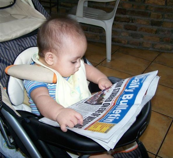 Start 'em young:  look who's reading the Negros Daily Bulletin now.  Robert Harland Jr, six month-old son of NDB contributor Robert Harland, seems totally engrossed by the news of the day.  (Photo Robert Harland)