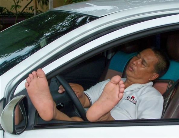 It's siesta time! This driver was spotted sound asleep in his car at the weekend in Bata Subdivision for what was no doubt a well- deserved rest. And he took the opportunity to give his feet a good airing too. (Photo Robert Harland)