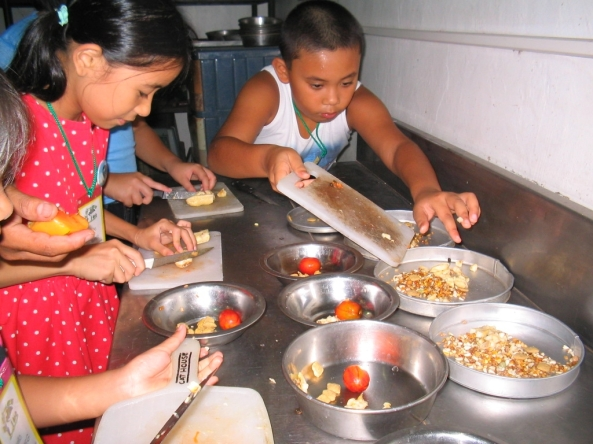 Preparing food for the animals - youngsters at a NFEFI Junior Zookeeper workshop