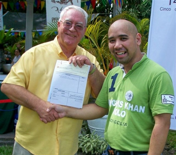 Robert Harland (left) receives his certificate and prize from Chef Richard Ynayan, director of the Institute for Culinary Arts at the University of St. La Salle