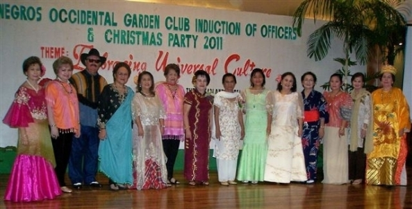 The 2012 Negros Occidental Garden Club board (l-r) Dr. Nena Nolido, social events; Ivy Visitacion, media affairs; Robert Harland, PIO; Daphne Javelosa, 2nd assistant secretary; Emma Lipa, 1st assistant secretary; Mepa Conde, secretary; Fe Remitio, president; Judge Emma Labayen, inducting officer;  Lourdes Mercado, 1st vice president; Gigi Flores, 2nd vice president; Ilde Guerrero, 1st asst. treasurer; Daday Javellana, 2nd asst. treasurer; Necena Ong, auditor; Lita Cruz, special projects and events.