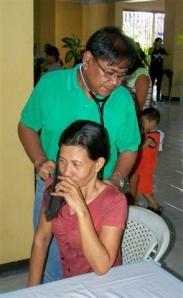 Dr. Joselito Maestral checks a patient