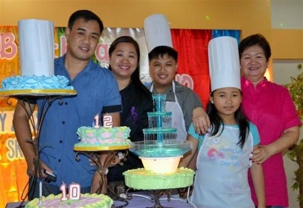 (l-r) Proud parents John and Shangrila Chua with birthday celebrators Dian and Dianne Chua and lola Emma Chua