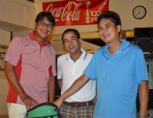 Group A champion, Max Javelona with past Marapara Rotary president Jojo Montinola and incumbent president Rico Cajili (l-r)