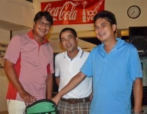 Group A champion, Max Javelona with past Marapara Rotary president Jojo Montinola and incumbent president Rico Cajili (l-r)