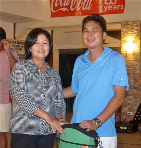 Ladies' champion Cynthia Capay with Marapara Rotary president Rico Cajili