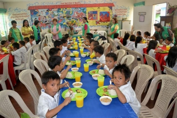 """Launches special school project  As part of its 50th anniversary celebrations, the Negros Occidental Garden Club, under the presidency of Fe Remitio, has launched a special program designed to provide meals for undernourished children in Bacolod schools.  Called 'Full Meal', the program kicked-off on Monday at the Rizal Elementary School with an initial batch of 40 children classified by the Department of Education as 'severely wasted'.  Said Lourdes Mercado, chair of the club's working committee: """"The project aims to supply at least one full meal a day for those children most in need. This will mean they can continue to attend school as they look forward to a nourishing meal each day. We all want our children to be healthy and cheerful.""""  For its part, the school is required to grow and maintain a sustainable vegetable garden, handle the cooking of the meals, identify those children most in need and follow-up the physical growth of each child.  """"This is a very beneficial project,"""" said May Bautista, Principal 4 at Rizal Elementary. """"Some families are too poor to feed their chidden properly and when there's hunger it makes it very difficult for a child to focus on lessons. So the Full Meal program will be a great help.""""  The project will run until December at which time the club and school will determine the next stage.  As part of Full Meal, the club will also host a Christmas party at the school for the children, teachers and volunteer helpers.  Founded in 1962, the Negros Occidental Garden Club is one of the oldest and most active clubs of its kind in the Philippines. It aims to promote, encourage, foster and cultivate interest in garden floriculture and community beautification as well as support local charitable projects."""