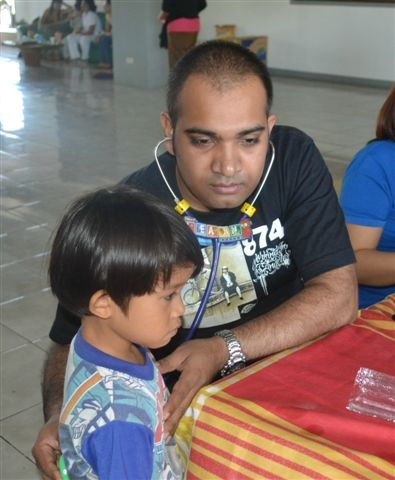 Nepalese doctor Yogendra Agrahari checks a young boy