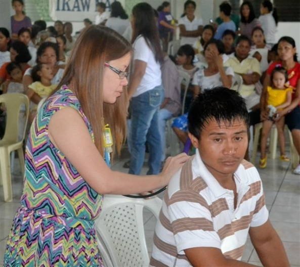 Dr. Michelle Gahaton from Riverside Hospital attending to a patient