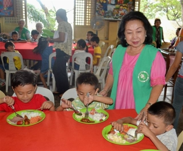Garden Club member Celia Ferrer with some of the 'Full Meal' recipients