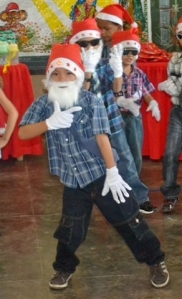 This very young Santa led the dancing