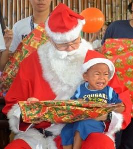 One little boy didn't seem too happy at meeting Santa