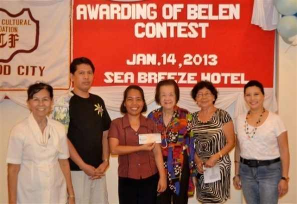 Danilo Cuello and Lerma Flores (2nd and 3rd right), representing St. Joseph the Worker church in Dona Juliana Heights, received a cash prize from the Bacolod Cultural Foundation (BCF) at an awards ceremony at the Sea Breeze Hotel on Monday. The church won the Most Symbolic category in the BCF's 2012 Belen Contest. Witnessed by Foundation members (l-r) president Araceli Mirano, Angie Echaus, Pacita Adeva and Elsie Coscolluela.