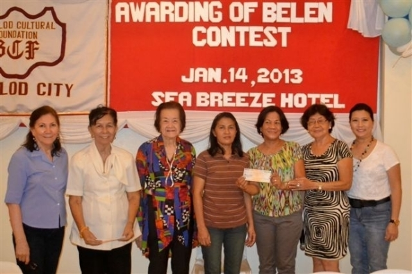 Rosemarie Tigley and Teresa Moises (4th and 5th right), representing the San Antonio Abad Church in Taculing, received a cash prize from the Bacolod Cultural Foundation (BCF) at an awards ceremony at the Sea Breeze Hotel on Monday. The church won the Most Creative and Innovative category in the BCF's 2012 Belen Contest. Witnessed by Foundation members (l-r) Emilie Zayc, president Aracli Mirano, Angie Echaus, Pacita Adeva and Elsie Coscolluela.  The winner in the Most Symbolic category was the St. Joseph the Worker Church in Dona Juliana Heights, while Most Artistic category title was won by the St. Isidore Parish Church in Tangub. Representatives received cash awards on behalf of their churches.