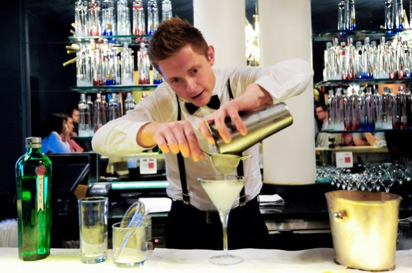 A bartender putting the finishing touches to a cocktail