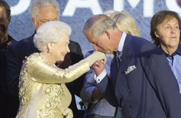 Prince Charles kisses his mother's hand at the Diamond Jubilee concert last June