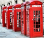 A row of iconic British red telephone boxes in London