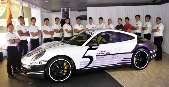 The PTRCA's tenth batch of 16 certified Porsche Service Mechatronics with the center's 5th anniversary Porsche 911 training car.