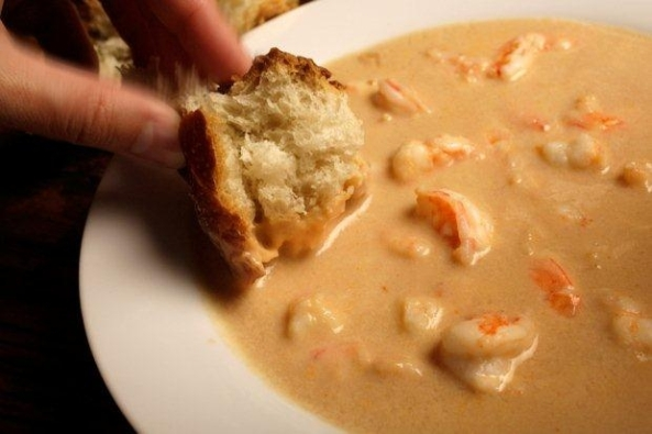 Soaking up the bisque with crusty French bread